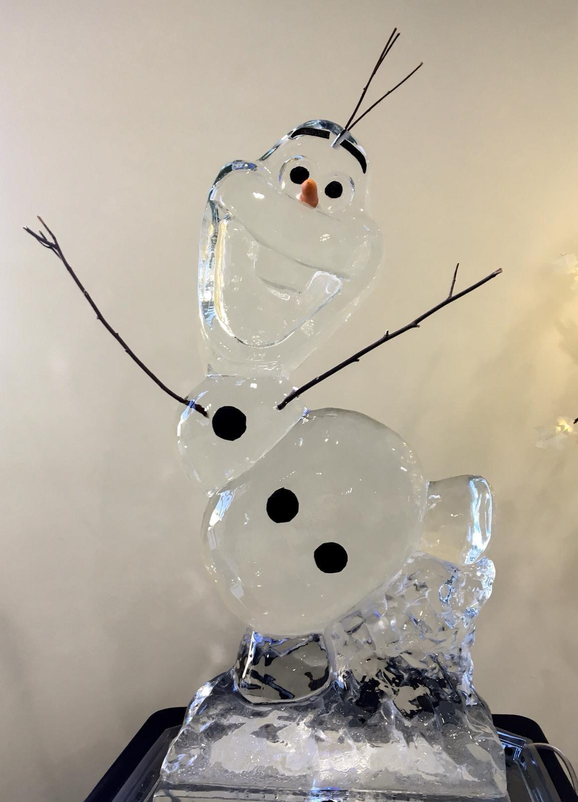 Olaf made from pure ice for a frozen theme party image with flash
