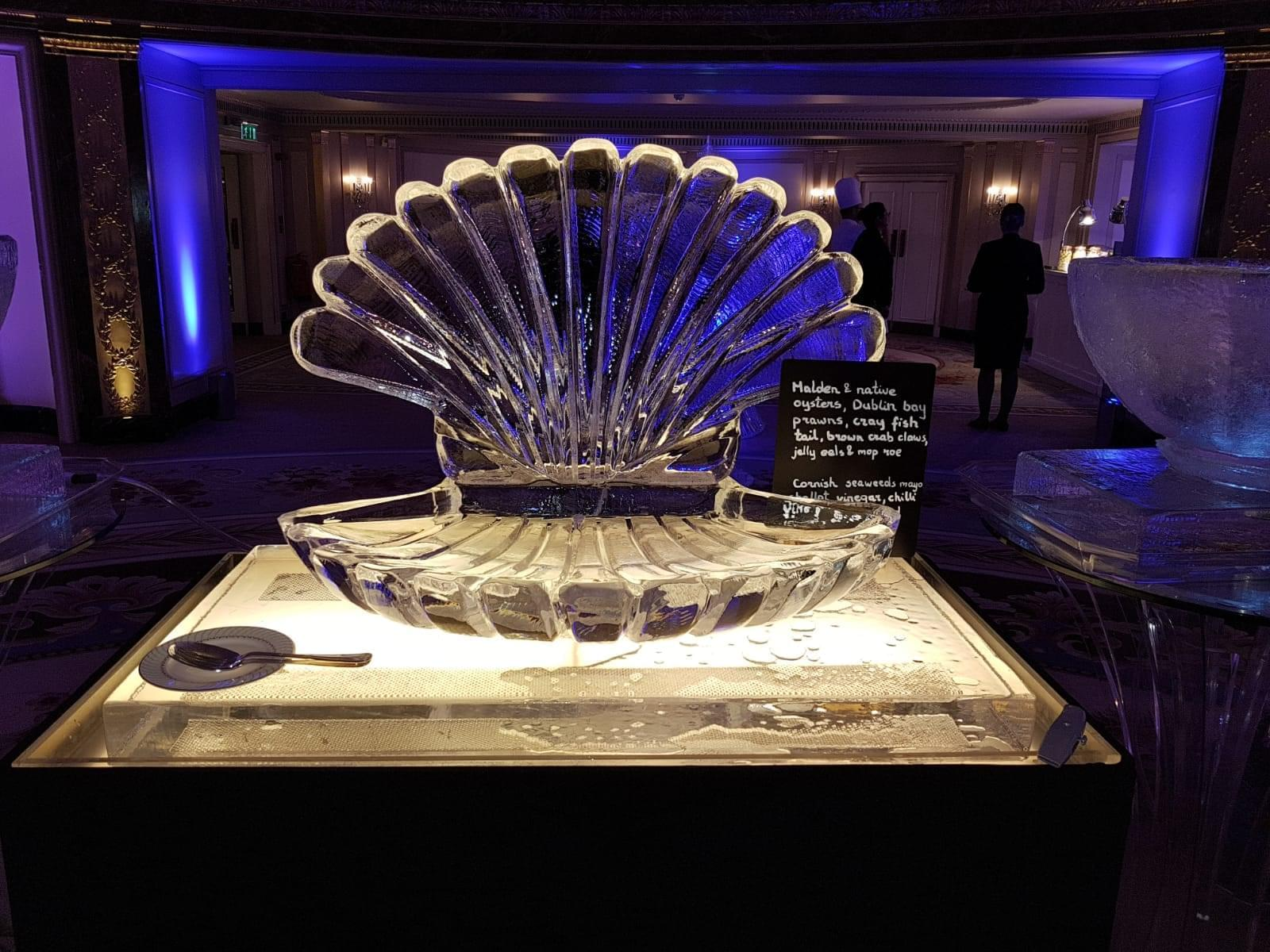 Open Scallop ice sculpture with lighting effect at a food display at the Dorchester Hotel in a fancy setting